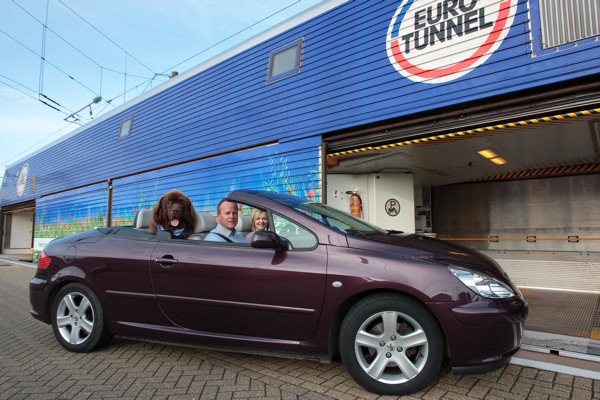 Newfoundland dog in convertible about to board Eurotunnel train