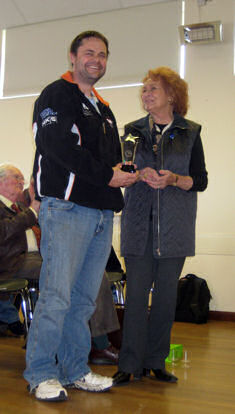 Steve Walker receiving trophy